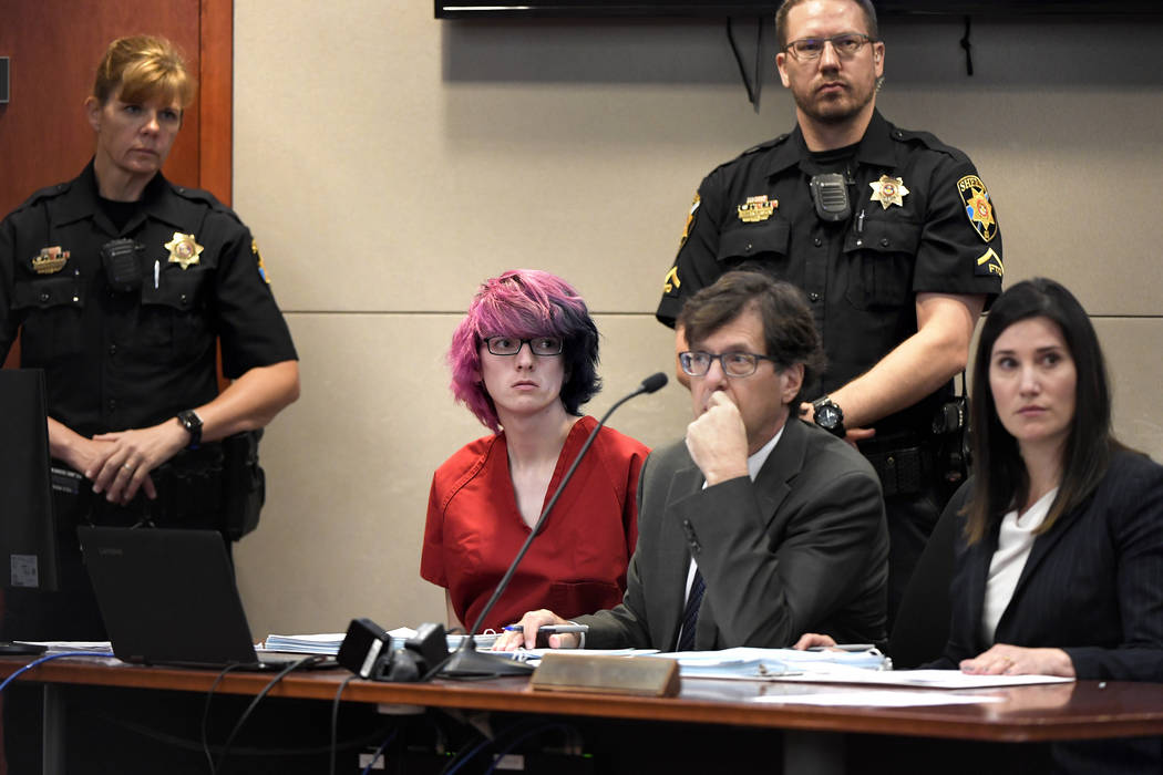 Devon Erickson, second from left, appears in court at the Douglas County Courthouse on Wednesda ...