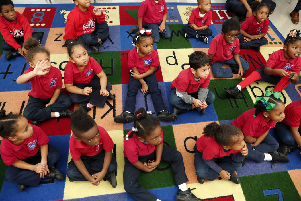 In this Tuesday, Dec. 18, 2018 photo, students participate in a pre-kindergarten class at Alice ...