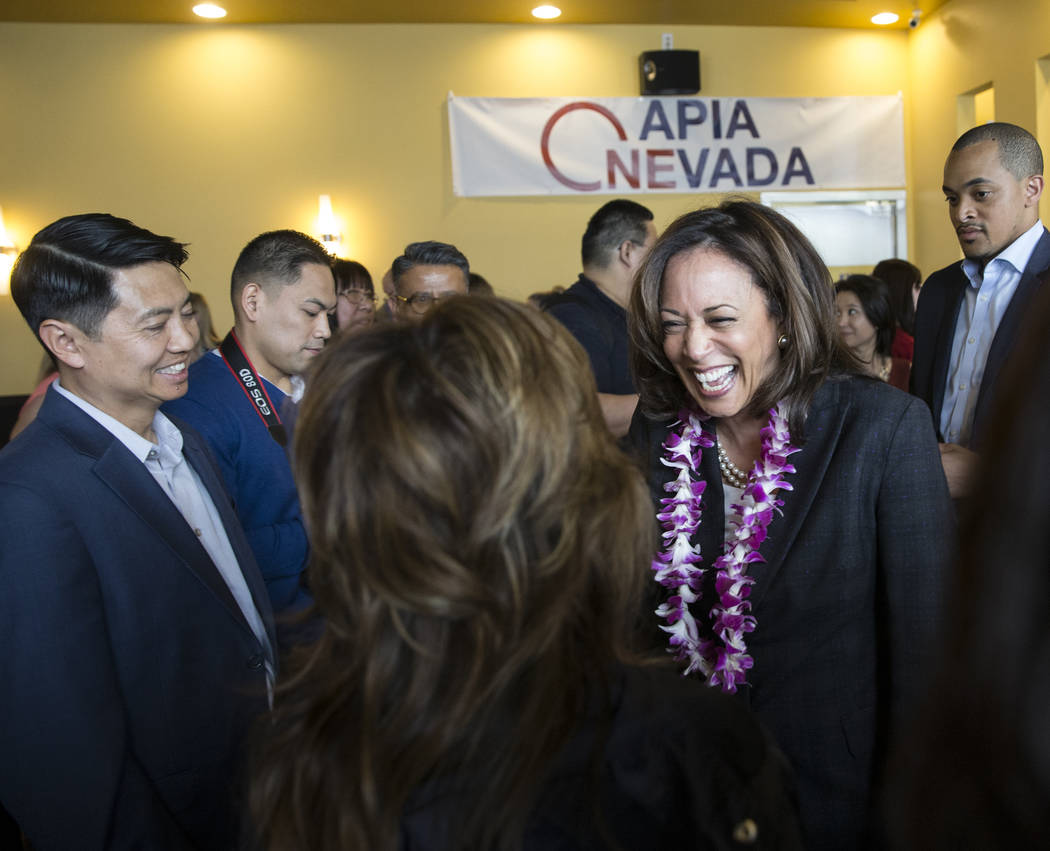 Presidential candidate Sen. Kamala Harris, right, D-Calif., speaks with guests during a meet an ...