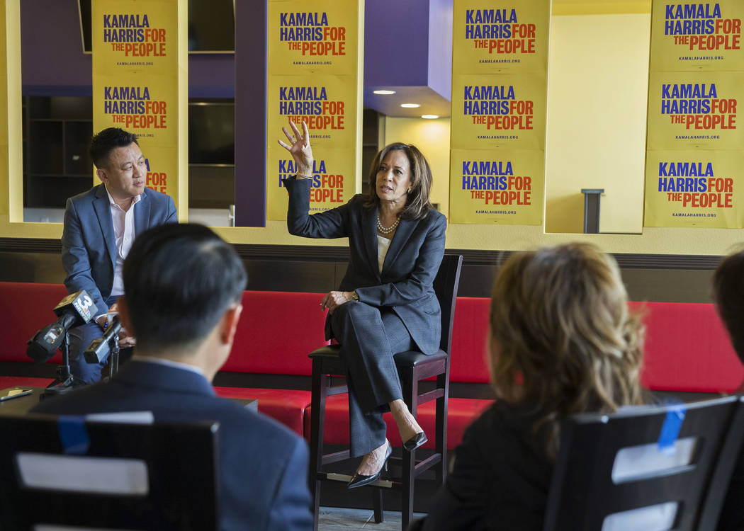 Presidential candidate Sen. Kamala Harris, middle, D-Calif., addresses the audience during a me ...
