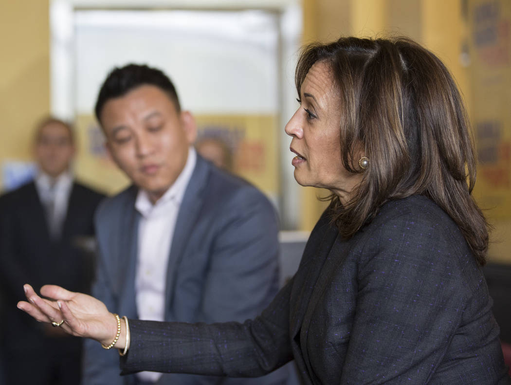 Presidential candidate Sen. Kamala Harris, right, D-Calif., addresses the audience during a mee ...