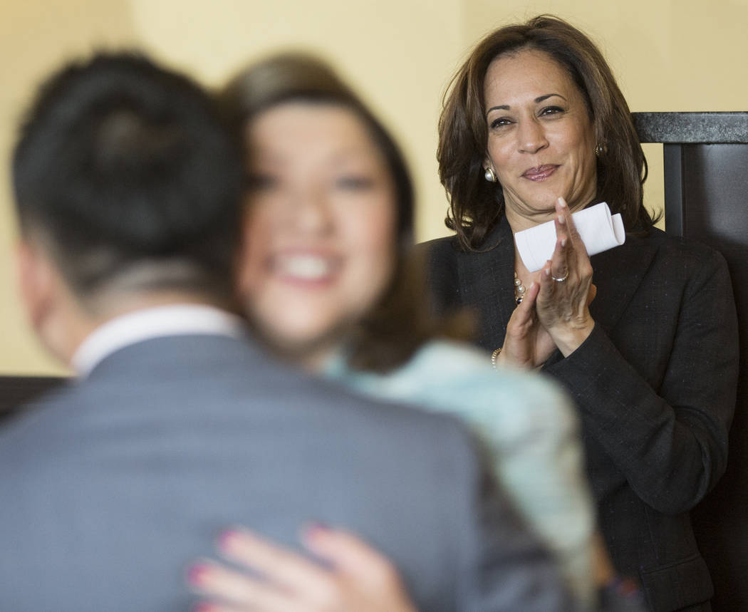 Presidential candidate Sen. Kamala Harris, right, D-Calif., is introduced during a meet and gre ...