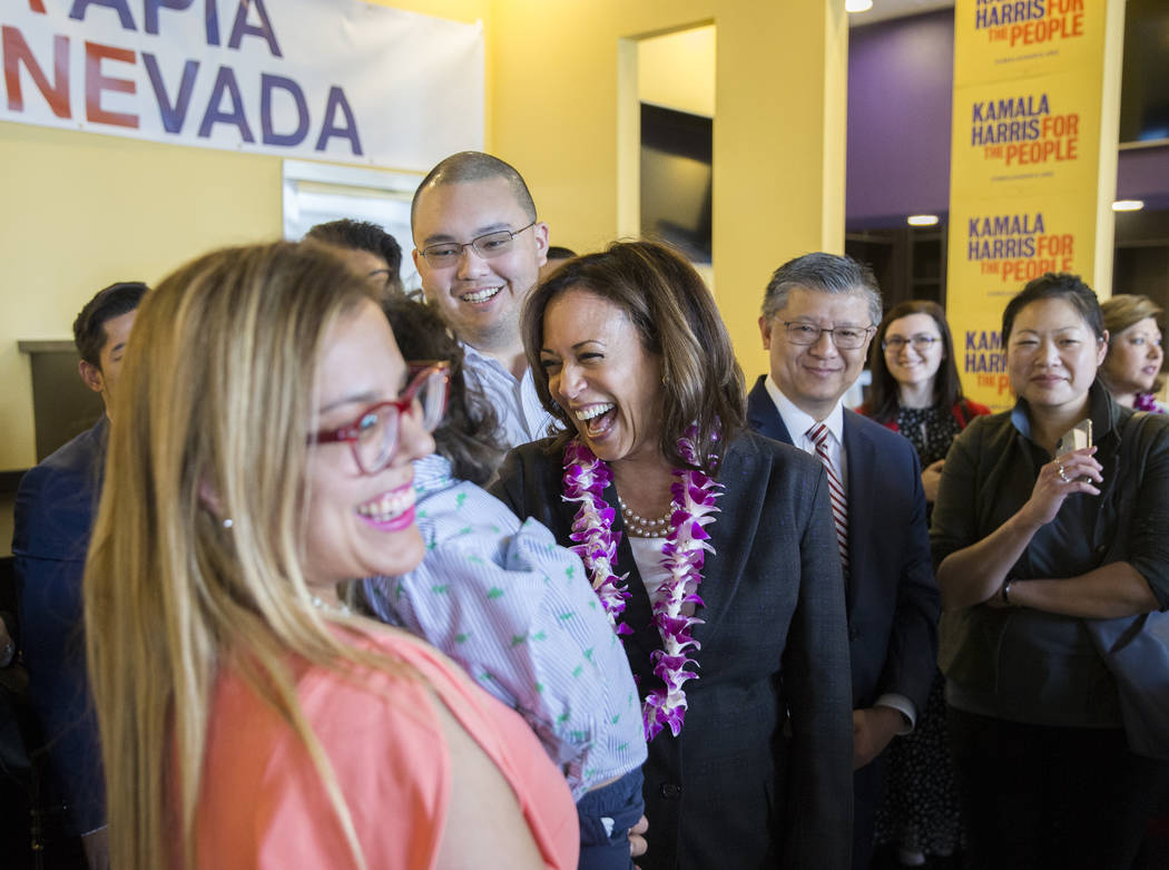 Presidential candidate Sen. Kamala Harris, middle, D-Calif., mingles with guests during a meet ...