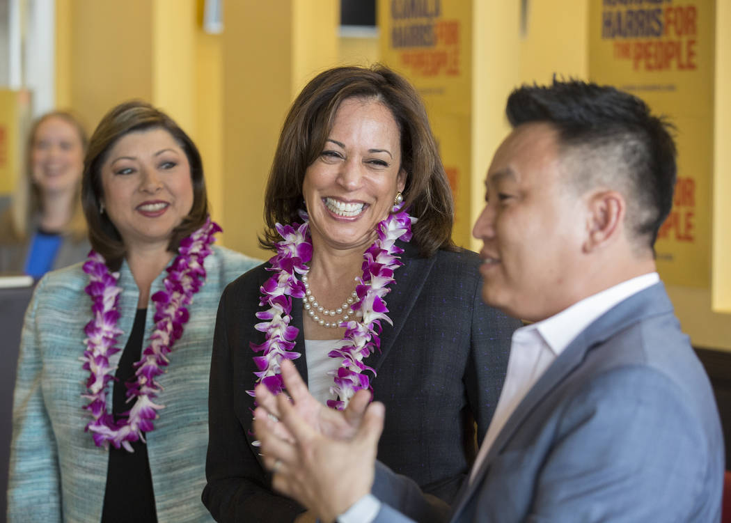 Presidential candidate Sen. Kamala Harris, middle, D-Calif., shares a laugh with guests during ...