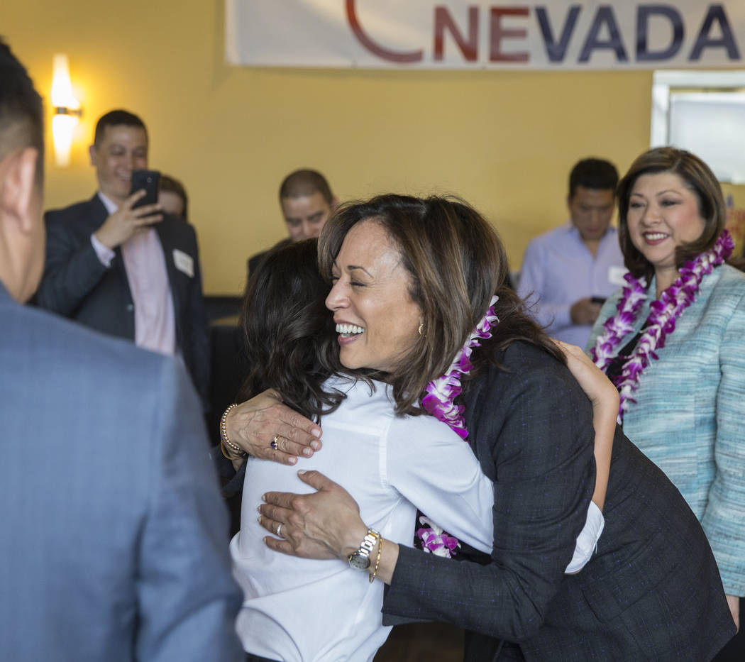 Presidential candidate Sen. Kamala Harris, right, D-Calif., gets a hug from Cevan Louie during ...