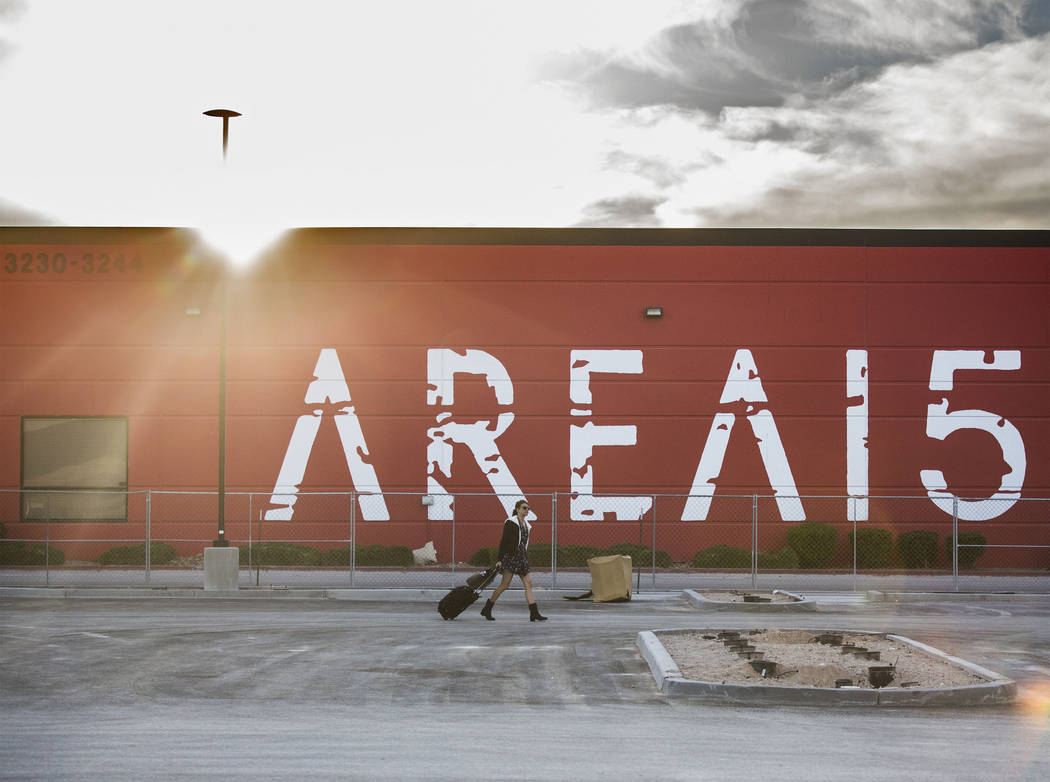 Jessica Fisher walks across the parking lot of AREA15, an experiential retail and entertainment ...