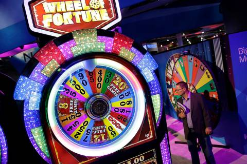 A Wheel of Fortune slot machine is seen at the IGT booth during the Global Gaming Expo in 2014 ...