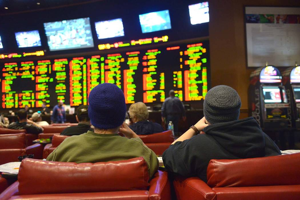 Gamblers sit in the sports book at Sunset Station casino in Henderson in 2015. (Las Vegas Revie ...