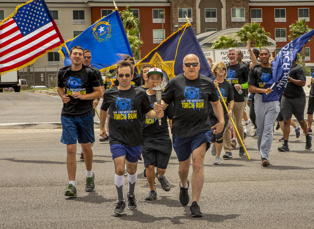 Nevada law enforcement officers and Special Olympics Nevada athletes make their way up Russell ...