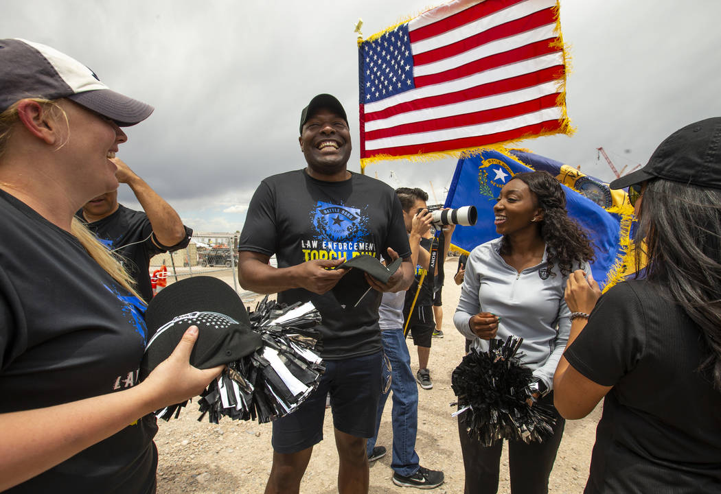 Terrence Thornton receives a new Raiders hat at the Las Vegas Stadium site during the Southern ...