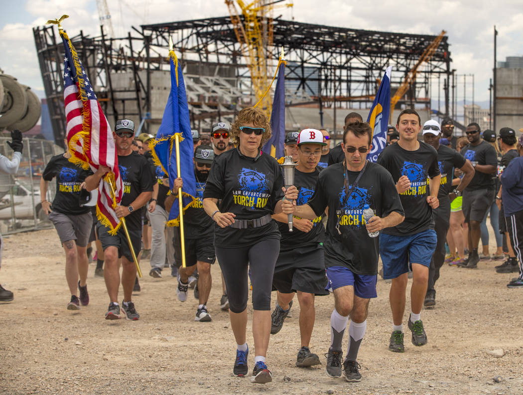 Nevada law enforcement officers and Special Olympics Nevada athletes run near the Las Vegas Sta ...