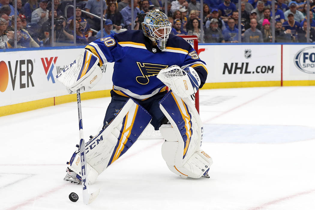 St. Louis Blues goaltender Jordan Binnington handles the puck against the San Jose Sharks durin ...