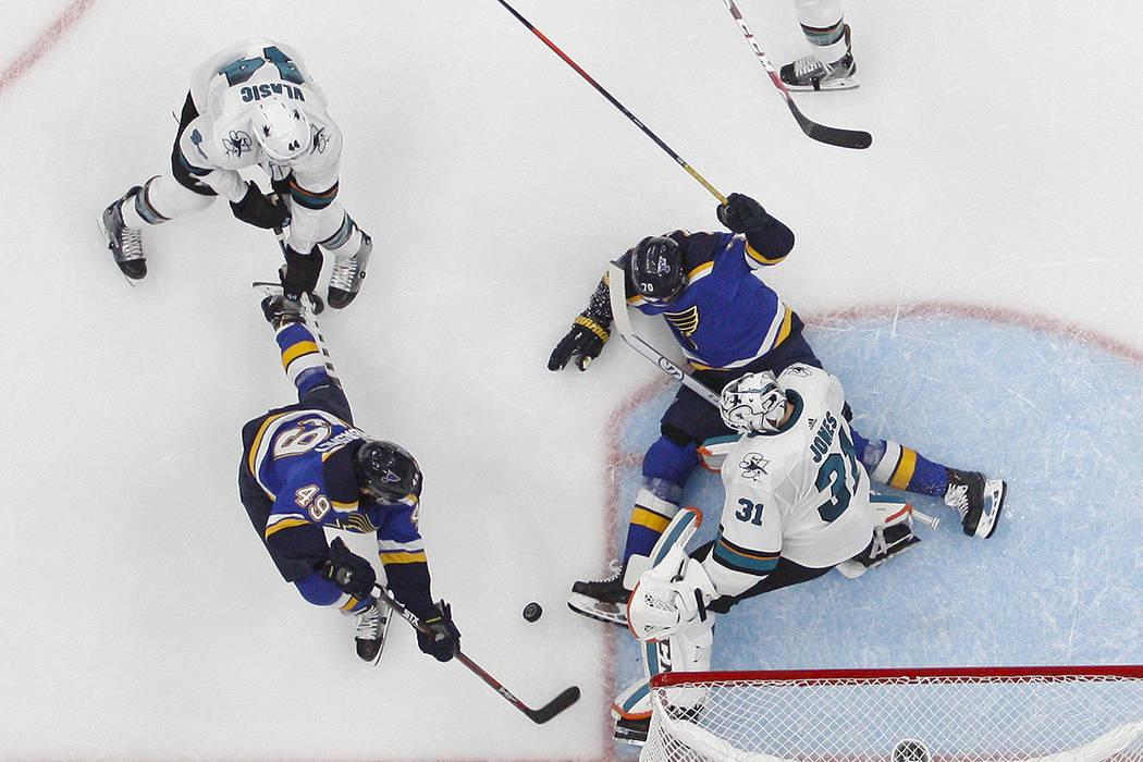 San Jose Sharks goaltender Martin Jones (31) blocks the puck as St. Louis Blues center Ivan Bar ...