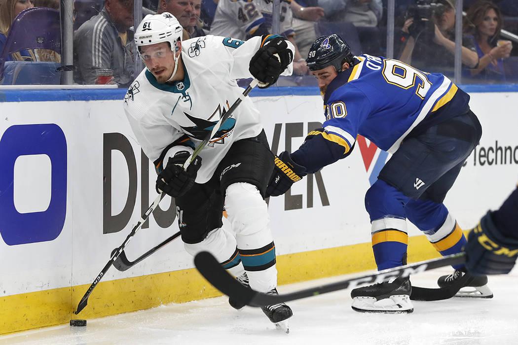San Jose Sharks defenseman Justin Braun (61) moves the puck ahead of St. Louis Blues center Rya ...