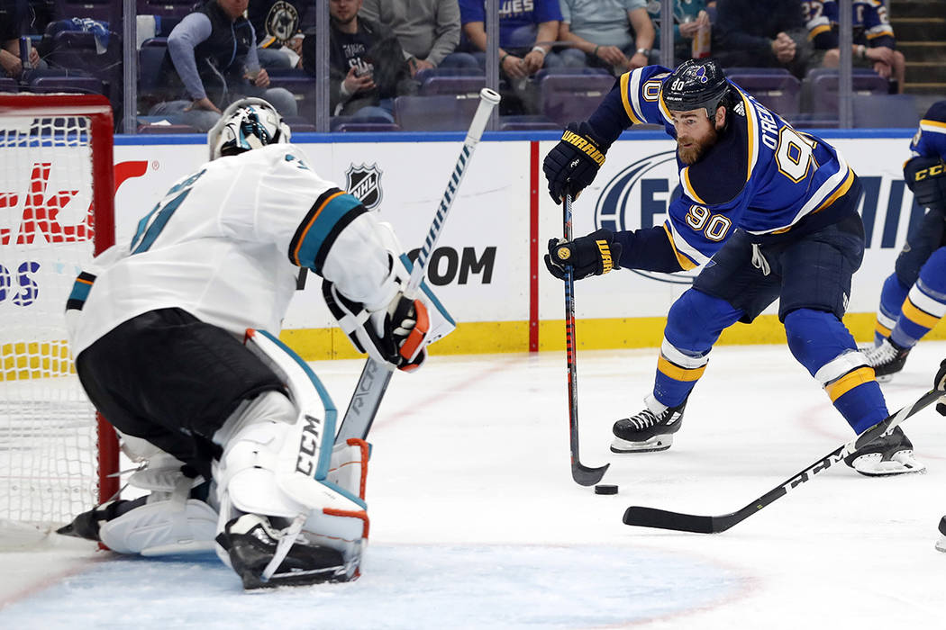 St. Louis Blues center Ryan O'Reilly (90) closes in on San Jose Sharks goaltender Martin Jones, ...