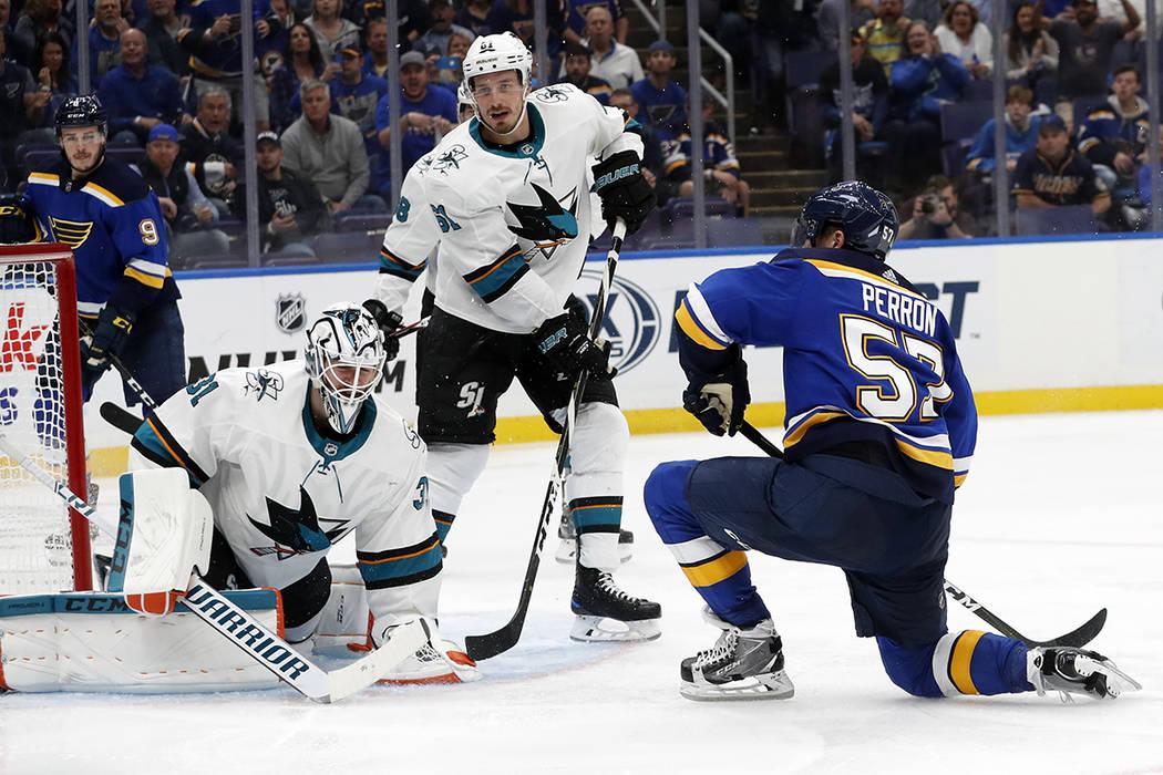 San Jose Sharks goaltender Martin Jones (31) blocks a shot by St. Louis Blues left wing David P ...