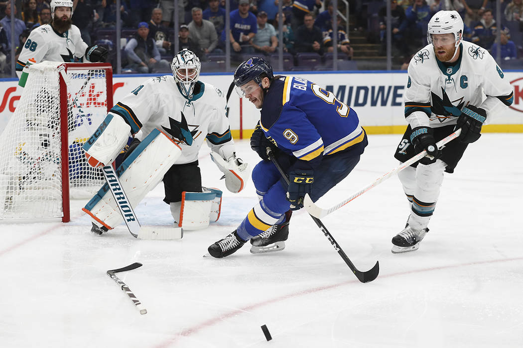 St. Louis Blues left wing Sammy Blais (9) chases the puck as it bounces away from San Jose Shar ...