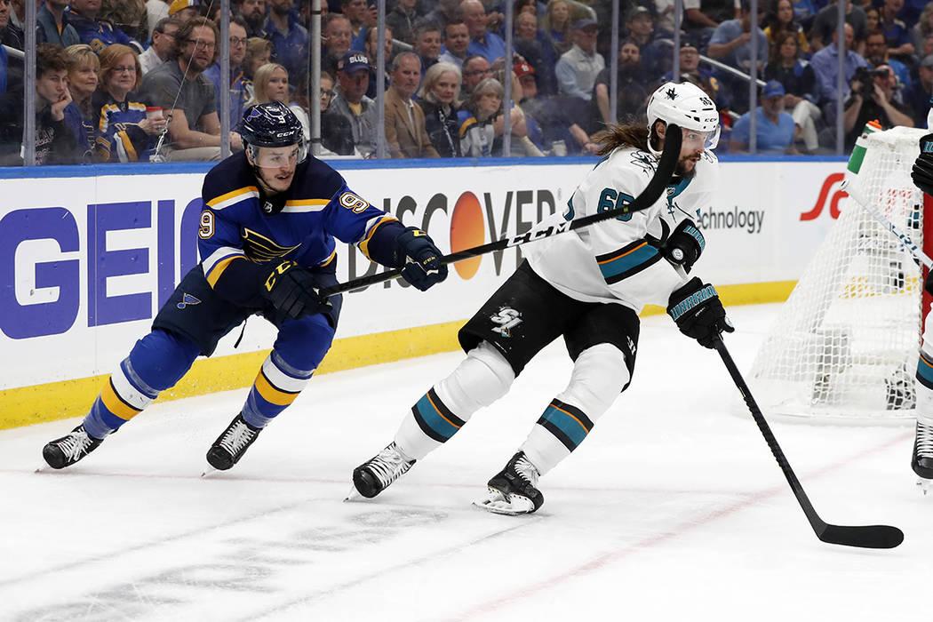 St. Louis Blues left wing Sammy Blais (9) tries to slow down San Jose Sharks defenseman Erik Ka ...