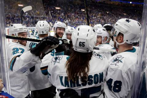 San Jose Sharks defenseman Erik Karlsson (65), of Sweden, is congratulated after scoring the wi ...