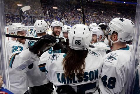 San Jose Sharks defenseman Erik Karlsson (65), of Sweden, is congratulated after scoring the wi ...