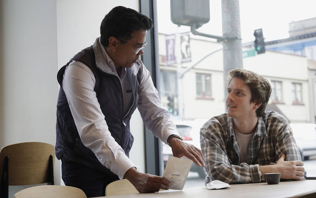 Klatch Coffee owner Bo Thiara, left, talks with customer Daniel Karel while giving Karel a tast ...
