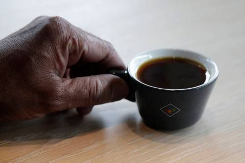 Klatch Coffee owner Bo Thiara holds a cup of Elida Natural Geisha coffee at his shop in San Fra ...