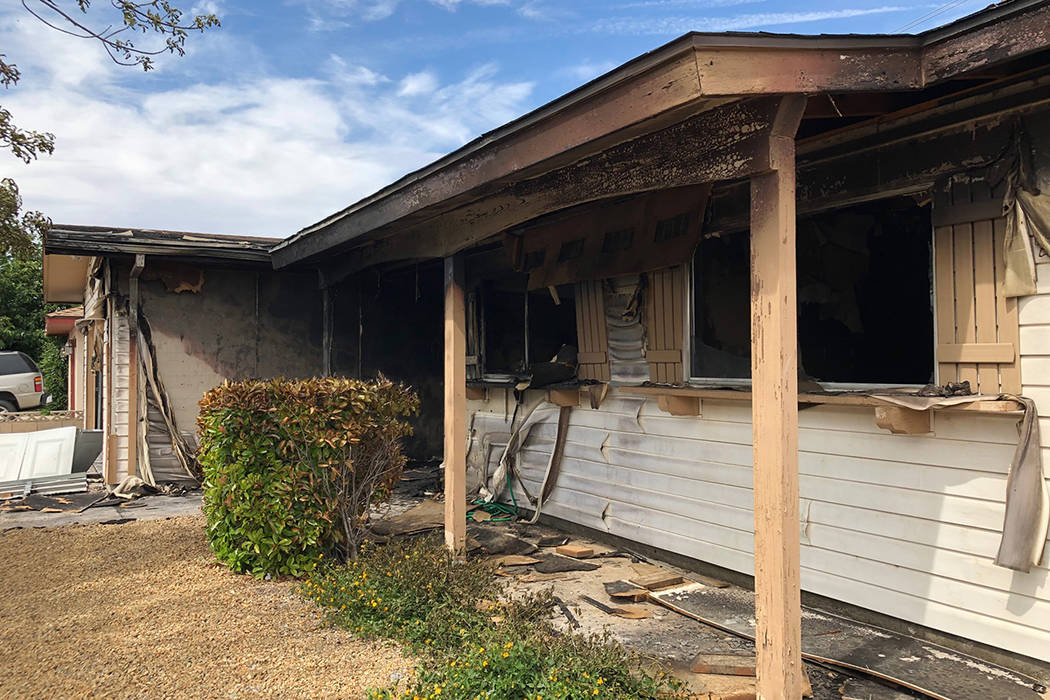 A home is heavily damaged by fire on the 1000 block of Joseph Kerwin Drive, near Charleston Bou ...