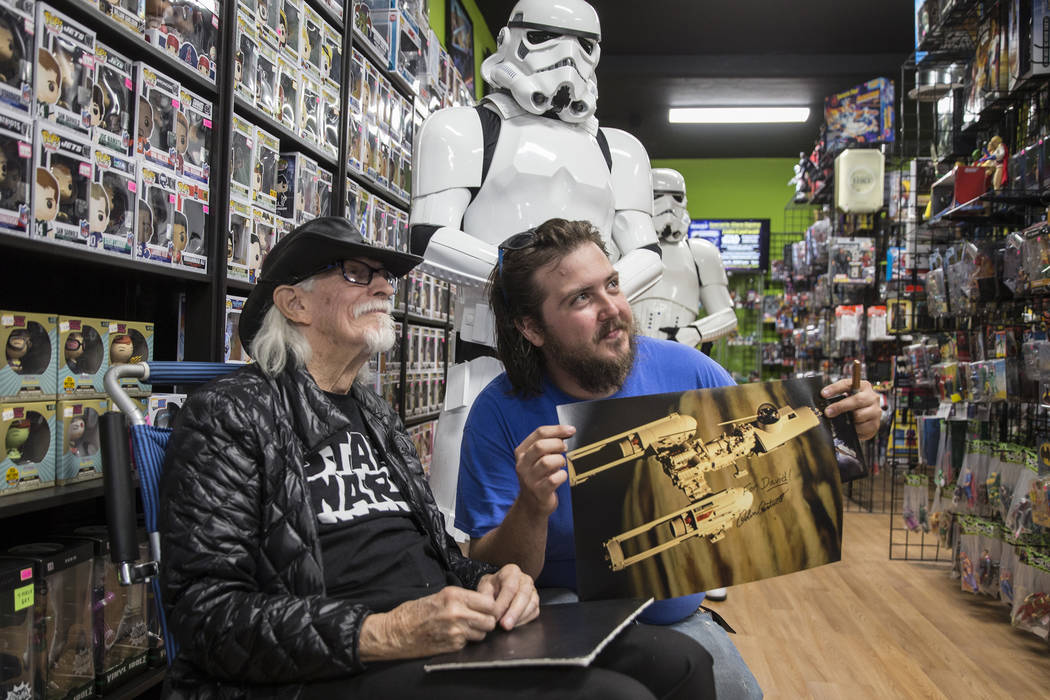 Colin Cantwell, left, concept artist and model builder for the original Star Wars movies, takes ...