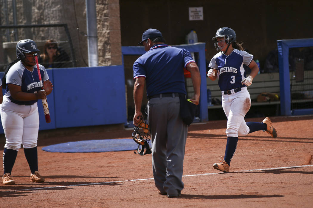 Shadow Ridge's Caitlin Covington (3) heads to home plate on her home run against McQueen during ...