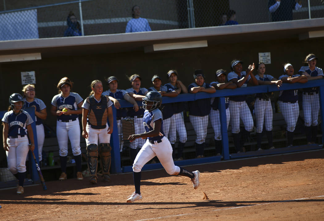 Shadow Ridge's Jasmine Martin (8) heads to home plate to score a run against McQueen during the ...