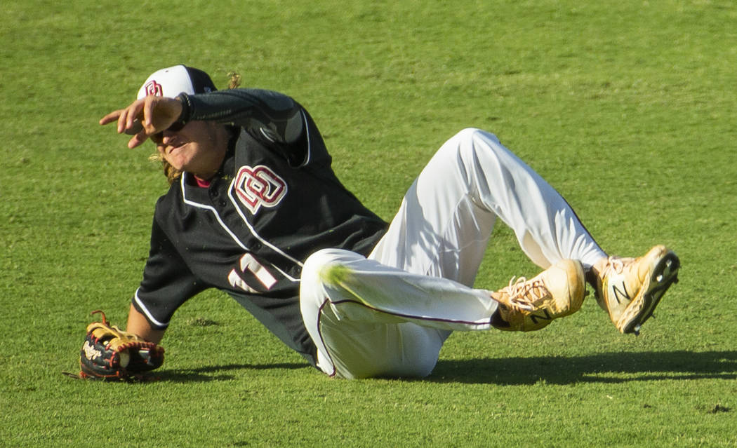 Desert Oasis' Josh Sharman (11) makes a sliding catch versus Reno during their Class 4A state b ...