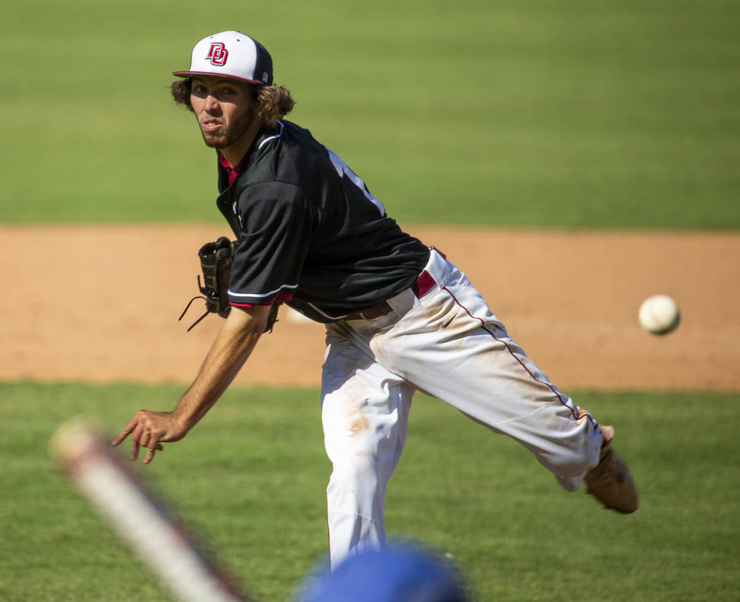 Desert Oasis pitcher Campbell Holt (15) throws to a Reno batter during their Class 4A state bas ...