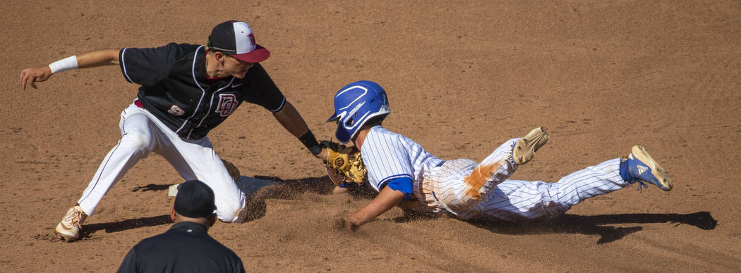 Desert Oasis' Zac Czerniawski (8) tags out Reno's Gunner Gouldsmith (8) attempting to steal sen ...