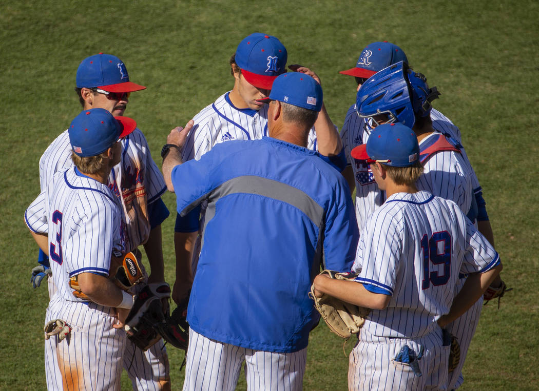 Reno head coach Pete Savage counsels his infielders versus Desert Oasis during their Class 4A s ...