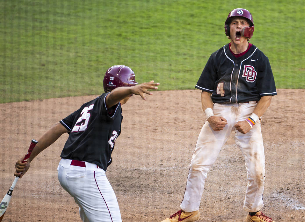 Desert Oasis' Parker Schmidt (4) celebrates another run over Reno during their Class 4A state b ...