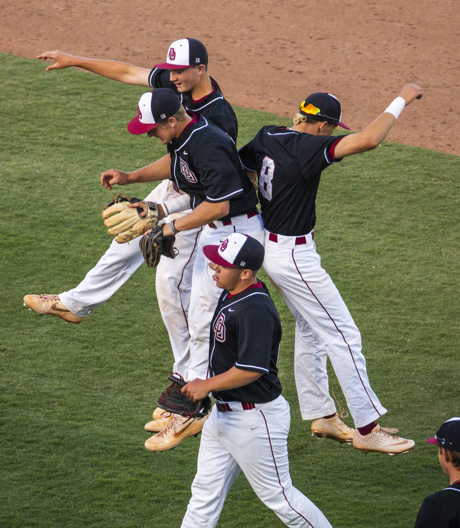 Desert Oasis players celebrate their win over Reno 8-6 following their Class 4A state baseball ...