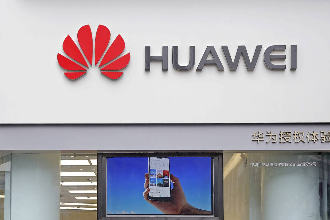 A logo of Huawei is displayed March 7, 2019, at a shop in Shenzhen, China's Guangdong province. ...