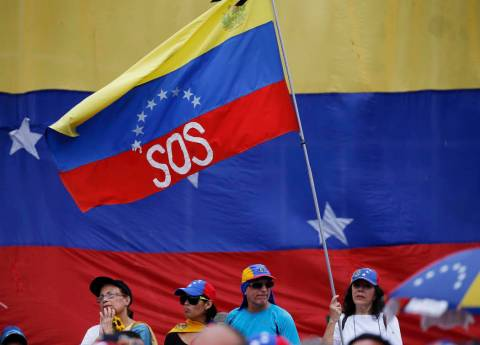 A supporter of Venezuela's opposition leader and self-proclaimed interim president Juan Guaid&# ...
