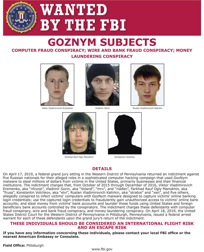 This undated poster released by the FBI includes five Russian fugitives that have been charged ...