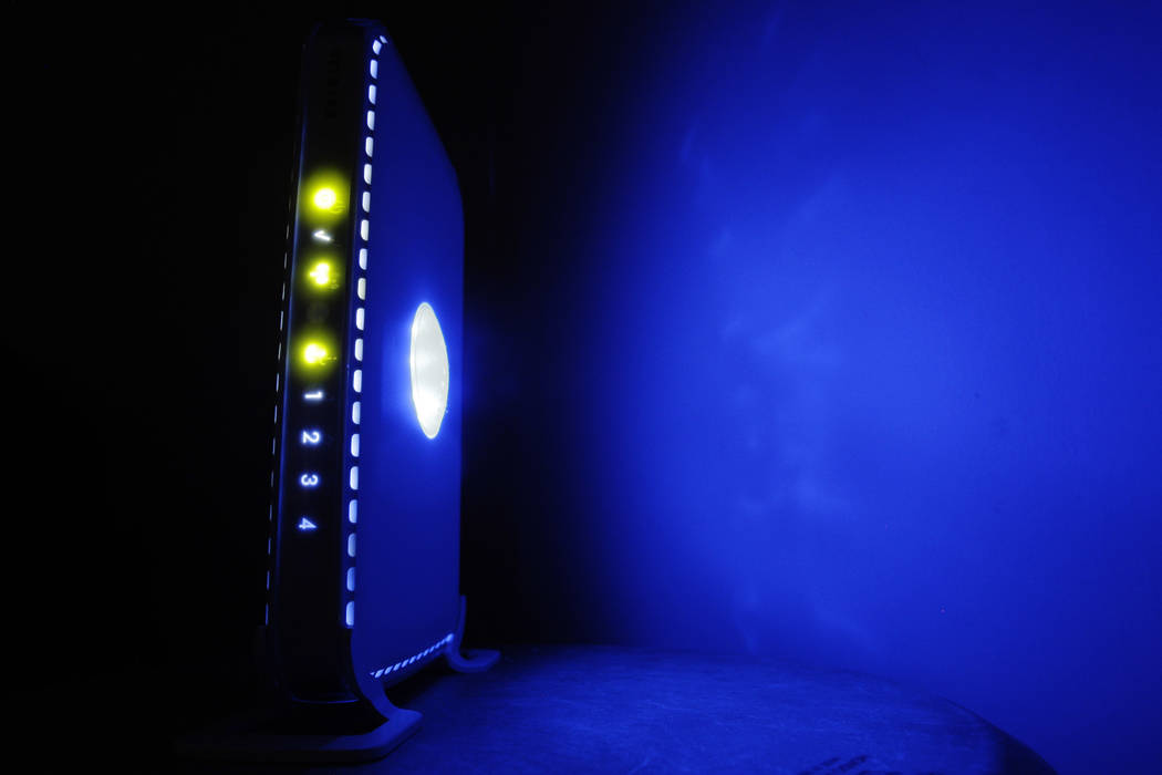A July 27, 2008, file photo shows a, LED-illuminated wireless router in Philadelphia. Officials ...