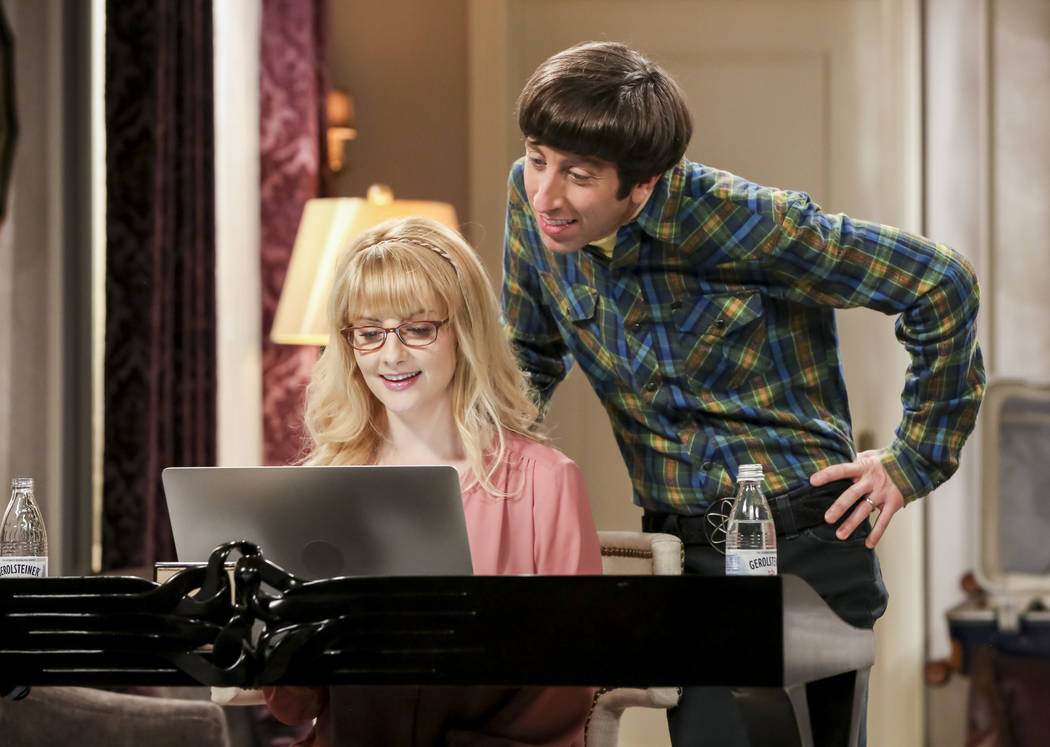 This image released by CBS shows Melissa Rauch, left, and Simon Helberg in a scene from the ser ...