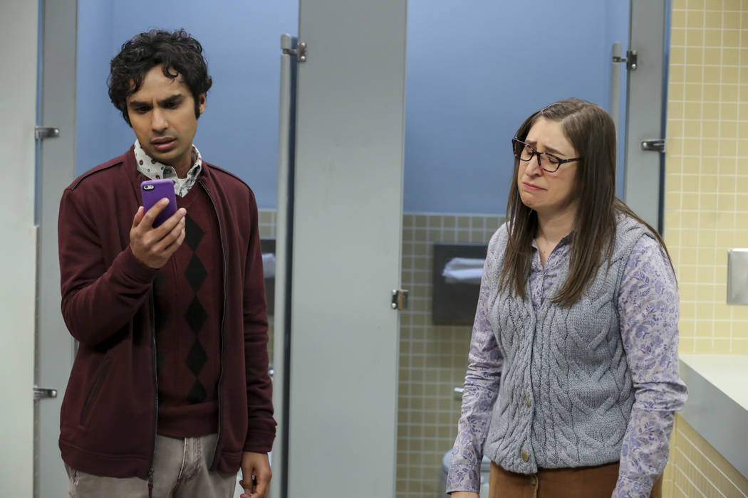 This image released by CBS shows Kunal Nayyar, left, and Mayim Bialik in a scene from the serie ...
