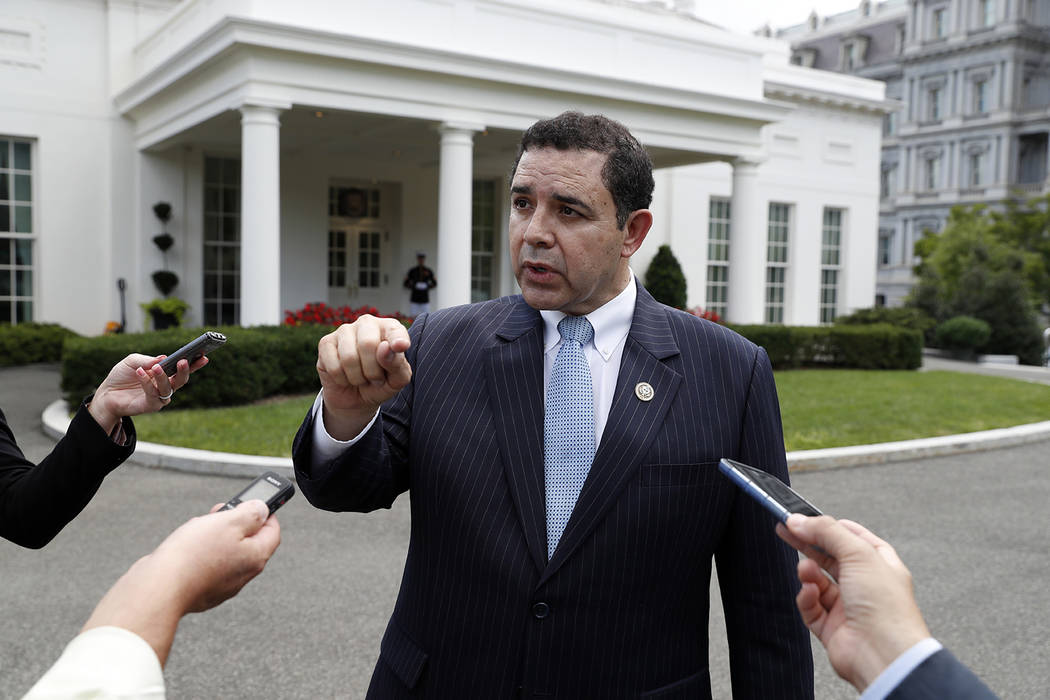 In this Sept. 13, 2017 file photo, Rep. Henry Cuellar, D-Texas, speaks with reporters outside t ...