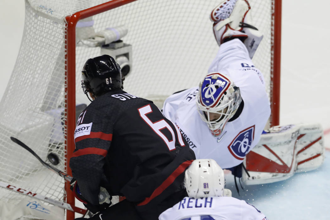 Canada's Mark Stone, left, fails to score past Henri Corentin Buysse of France, right, during t ...