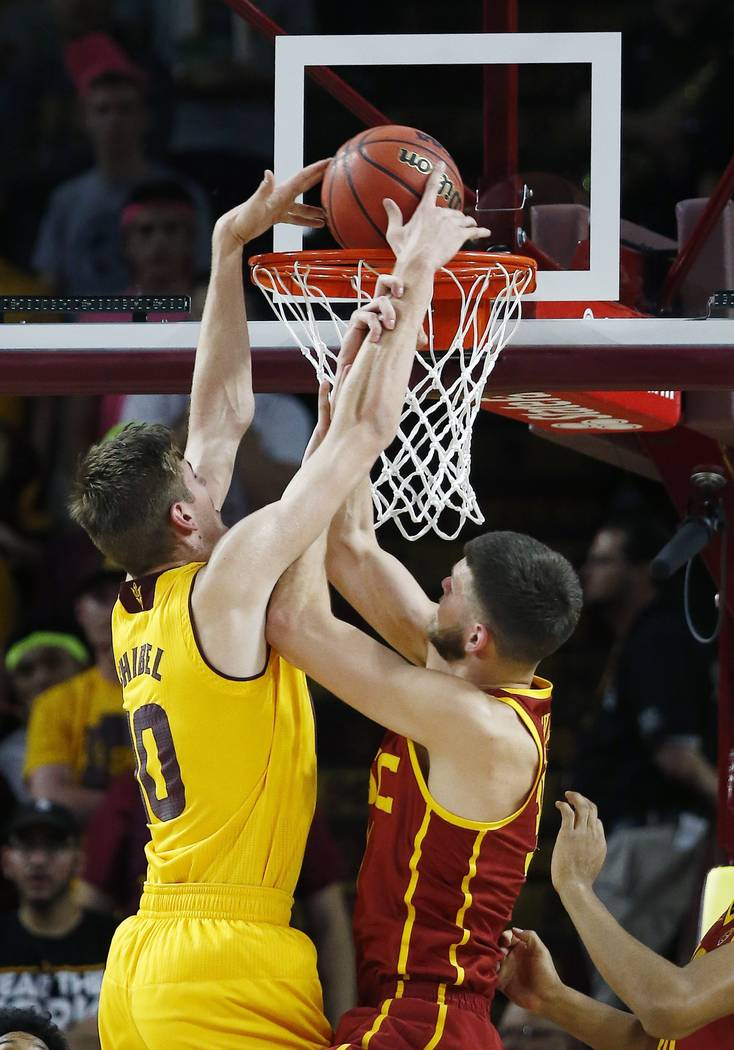 Arizona State forward Vitaliy Shibel, left, dunks against Southern California forward Nick Rako ...