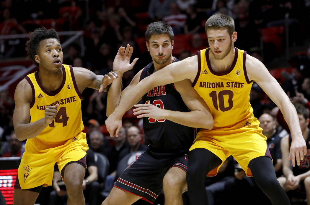 Arizona State's Kimani Lawrence (14) and Vitaliy Shibel (10) compete with Utah's Novak Topalovi ...