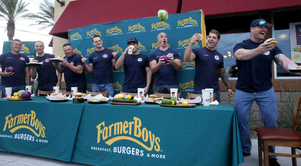 Clark County and Las Vegas firefighters prepare for a burger eating competition at Farmer Boys ...