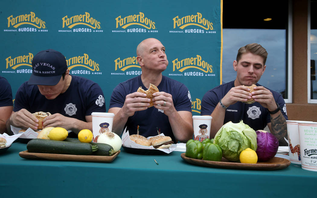 Las Vegas firefighters from left, Toby Brown, Allen McFall and Kelby Lytle compete against Clar ...