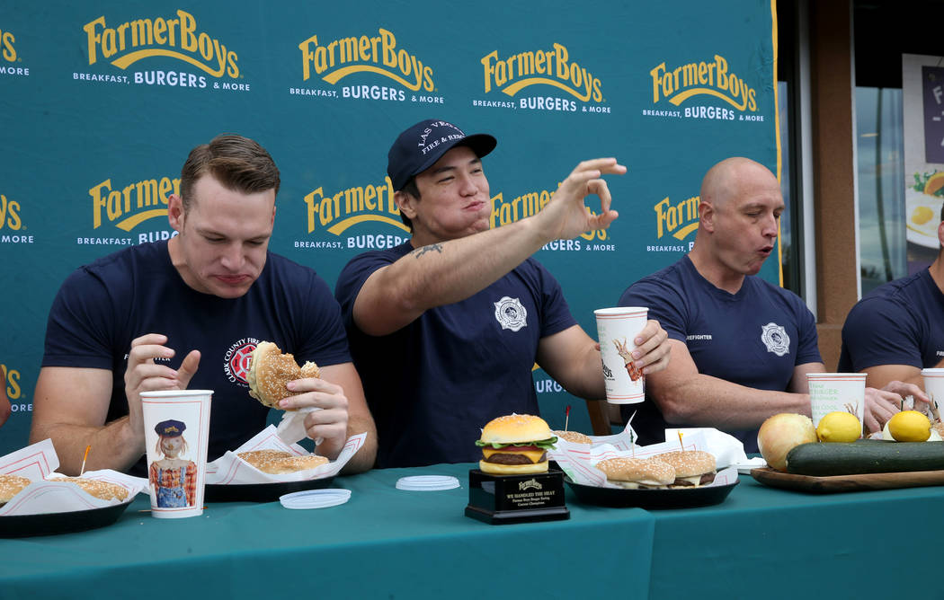 Clark County firefighter Shane Salmon, from left, competes with Las Vegas firefighters Toby Bro ...