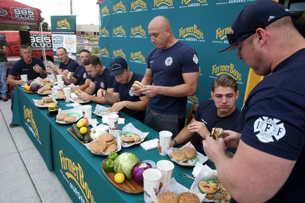 Clark County and Las Vegas firefighters in a burger eating competition at Farmer Boys at 5955 S ...